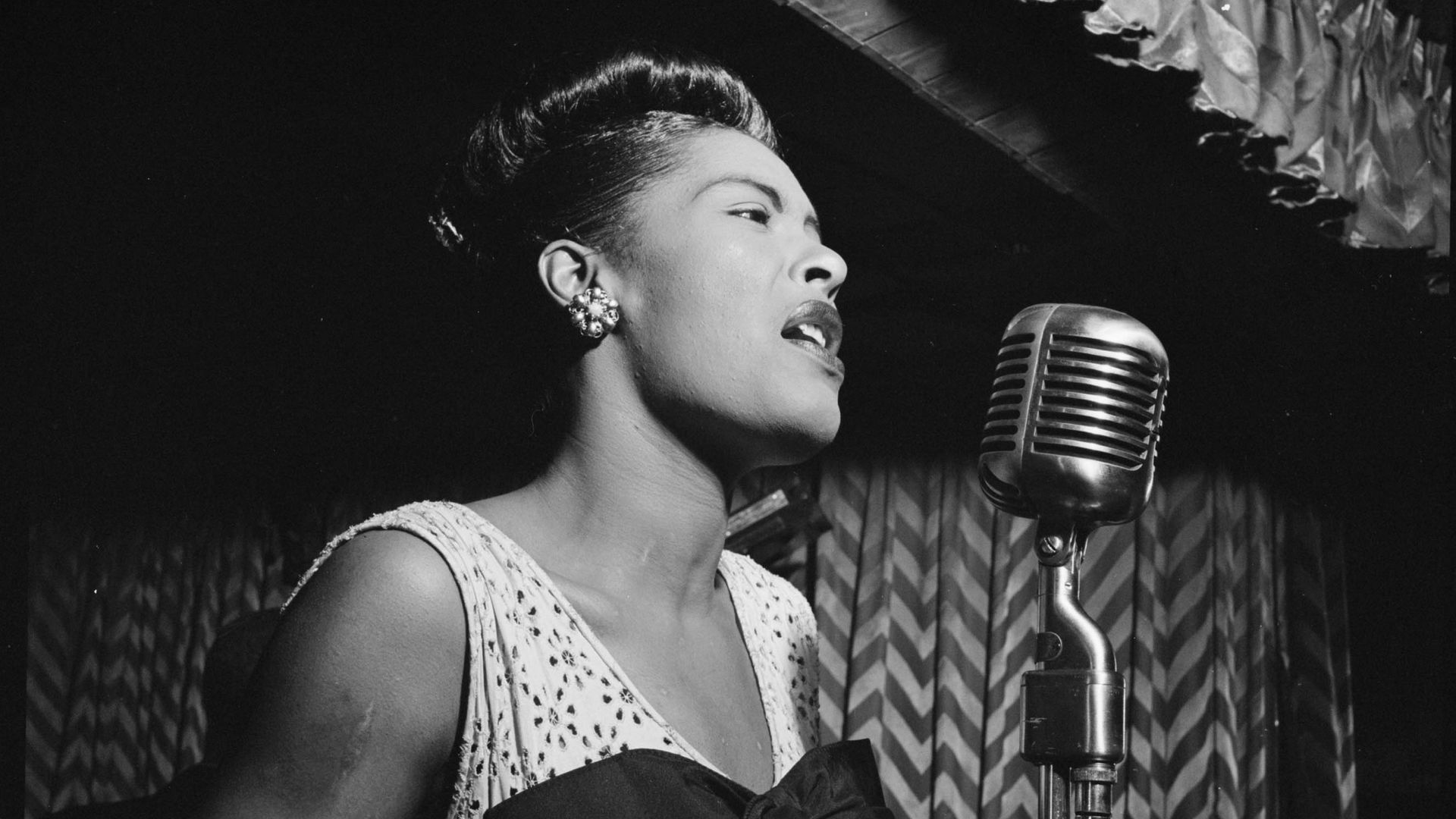 American jazz singer Billie Holiday is shown performing at the Club Downbeat in Manhattan in February 1947.